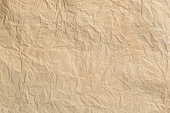 istock Crumpled old paper background and the texture. 1140209280