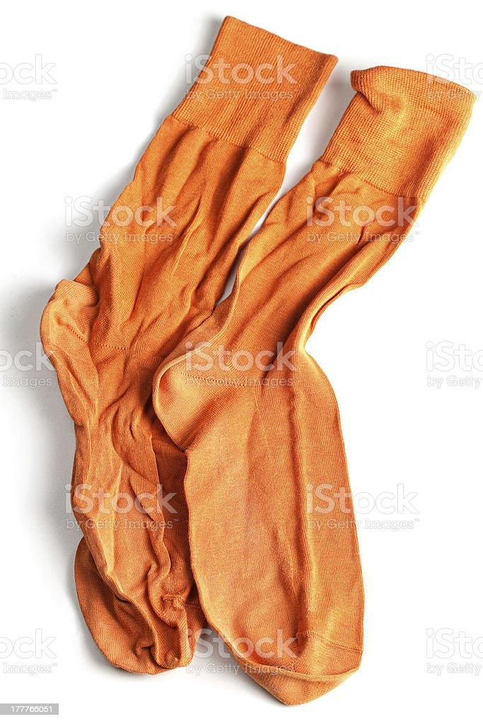 Crumpled orange socks stock photo