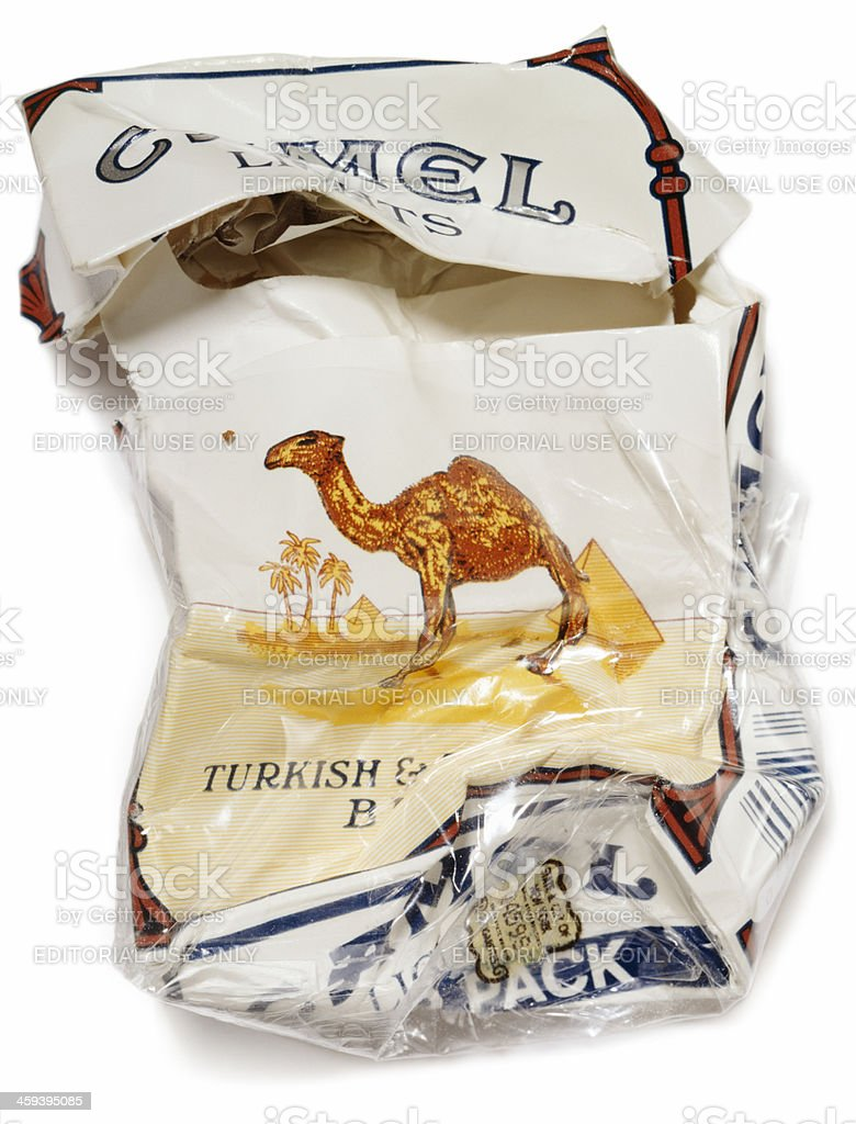 crumpled packet of camel cigarettes on white stock photo 459395085