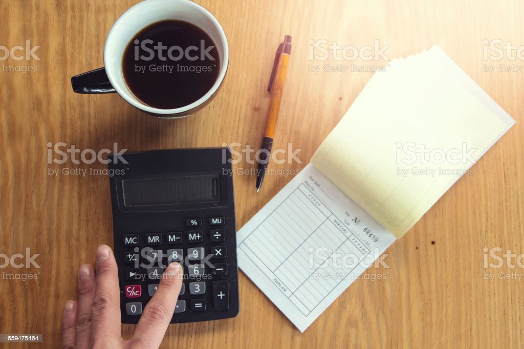 crumpled paper balls, notepad on desk and coffee