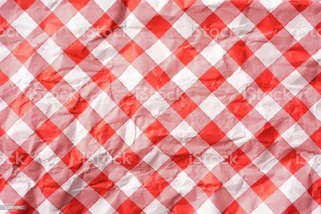 Crumpled paper napkin of pink mesh pattern texture background stock photo