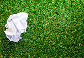 istock Crumpled paper on Green grass background 485575226
