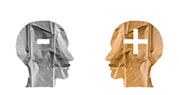 Crumpled paper shaped as a human heads and plus and minus signs. Positive and negative concept. Crumpled paper shaped as a human heads and plus and minus signs. Positive and negative concept. minus sign stock pictures, royalty-free photos & images