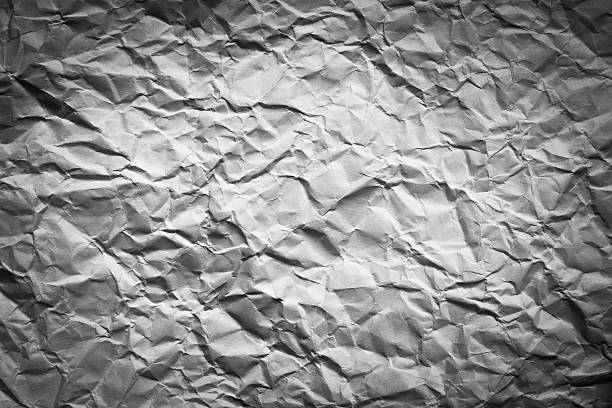 crumpled  paper texture with vignette stock photo