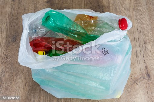 istock Crumpled plastic bottles in a carrier bag 842625486