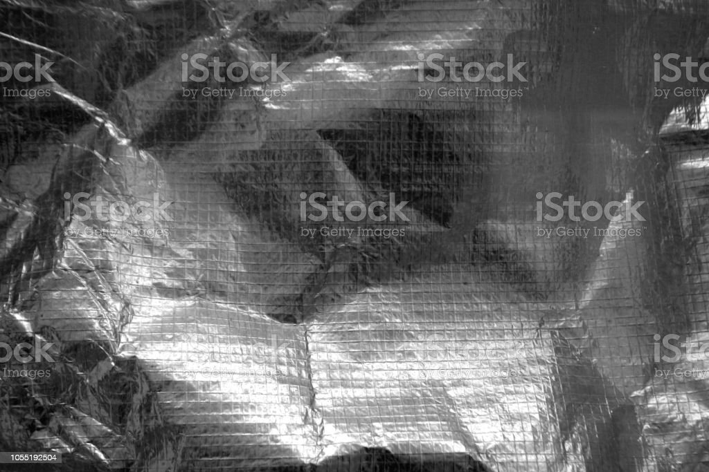 Crumpled plastic textile texture in black and white stock photo