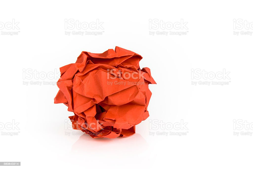 Crumpled red paper ball stock photo