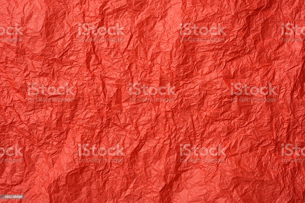 Crumpled red wrapping paper texture background stock photo