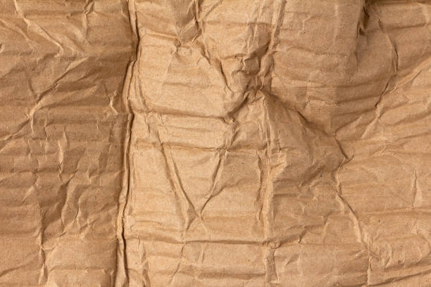 Crumpled sheet of corrugated cardboard texture stock photo