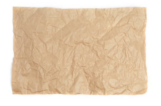 Crumpled sheet of kraft paper on a white background as a template for a backdrop stock photo