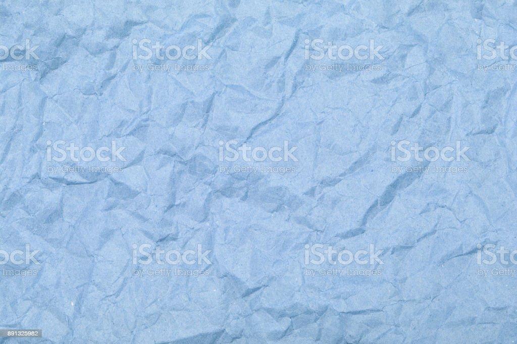 Crumpled sheet of paper. Texture closeup. stock photo