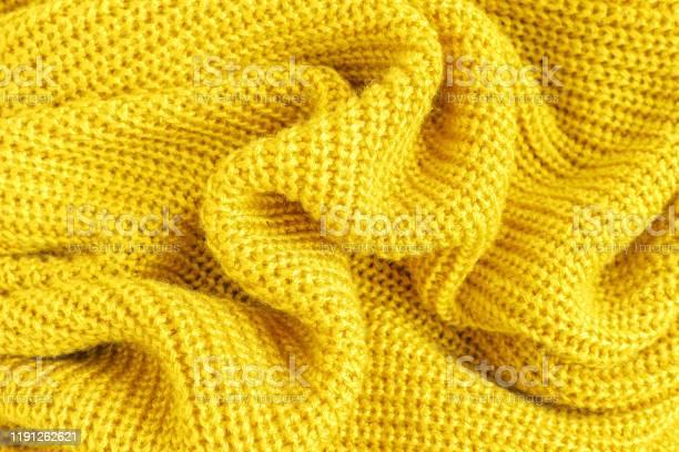 Crumpled soft knitted fabric of yellow fluffy woolen yarn close up picture id1191262621?b=1&k=6&m=1191262621&s=612x612&h=lrfyd2mknwo4cc27 0wxx38vi7n313uz0kohc9wi91m=