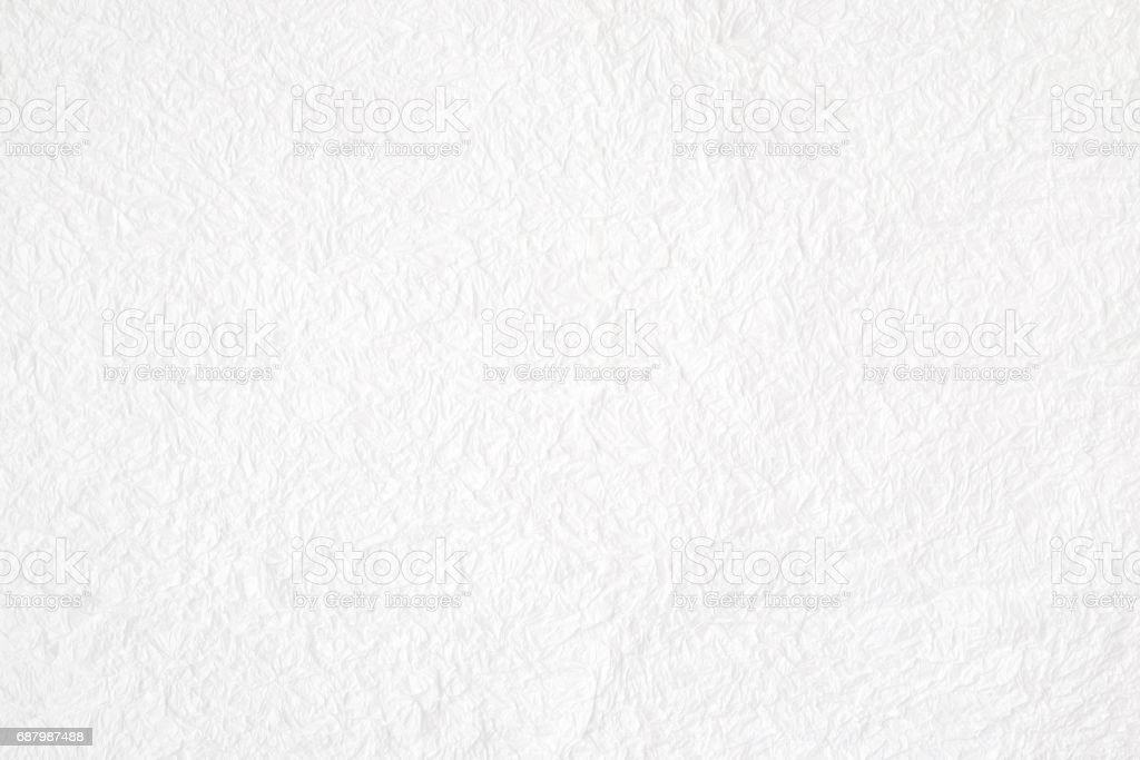 Crumpled white mulberry paper textured background, detail closed up stock photo