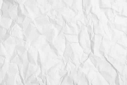 Old crumpled sheet of white paper