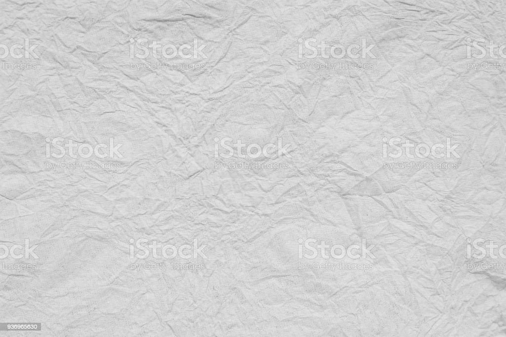 Crumpled white paper texture background. Recycle blank page creased material or sheet. stock photo