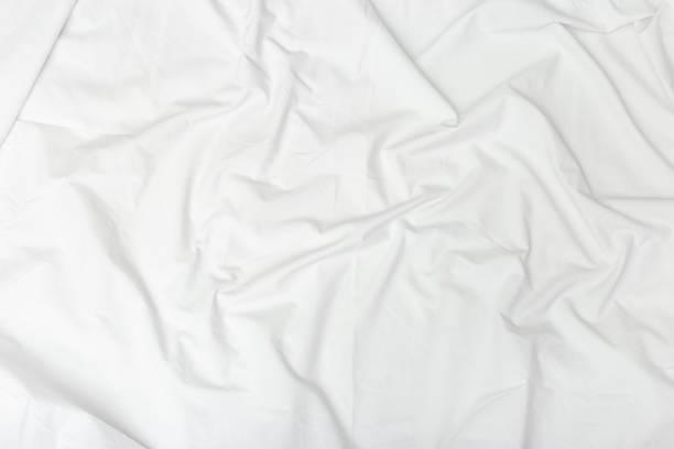 crumpled white sheet.  textile background. fabric texture. natural cotton sheet - lenzuolo foto e immagini stock