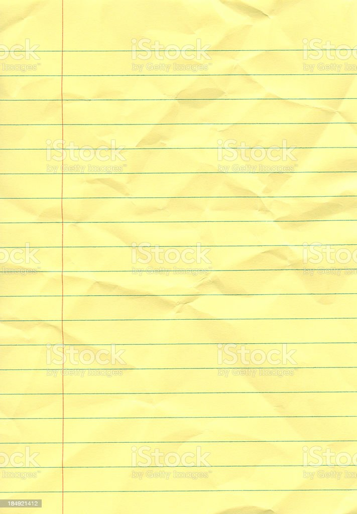 Crumpled yellow notepad stock photo