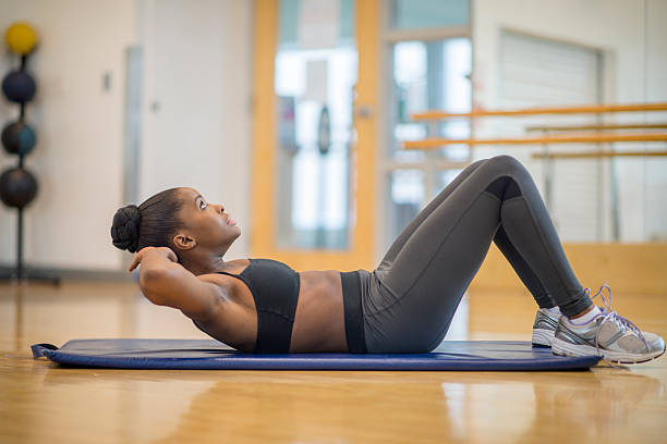 crunches - sit ups stock photos and pictures