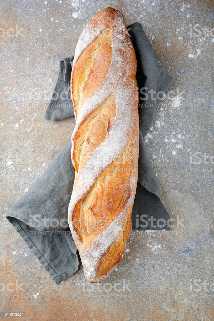Crunchy Baguette on slate stock photo