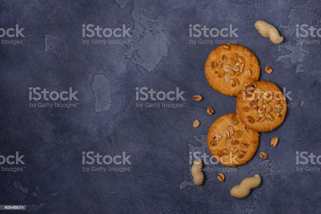 Crunchy cookies with peanuts on table stock photo