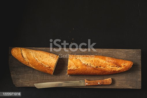 Crunchy french baguette and kitchen knife.