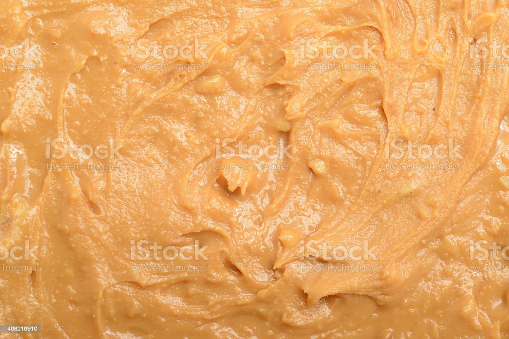 Crunchy peanut butter background stock photo