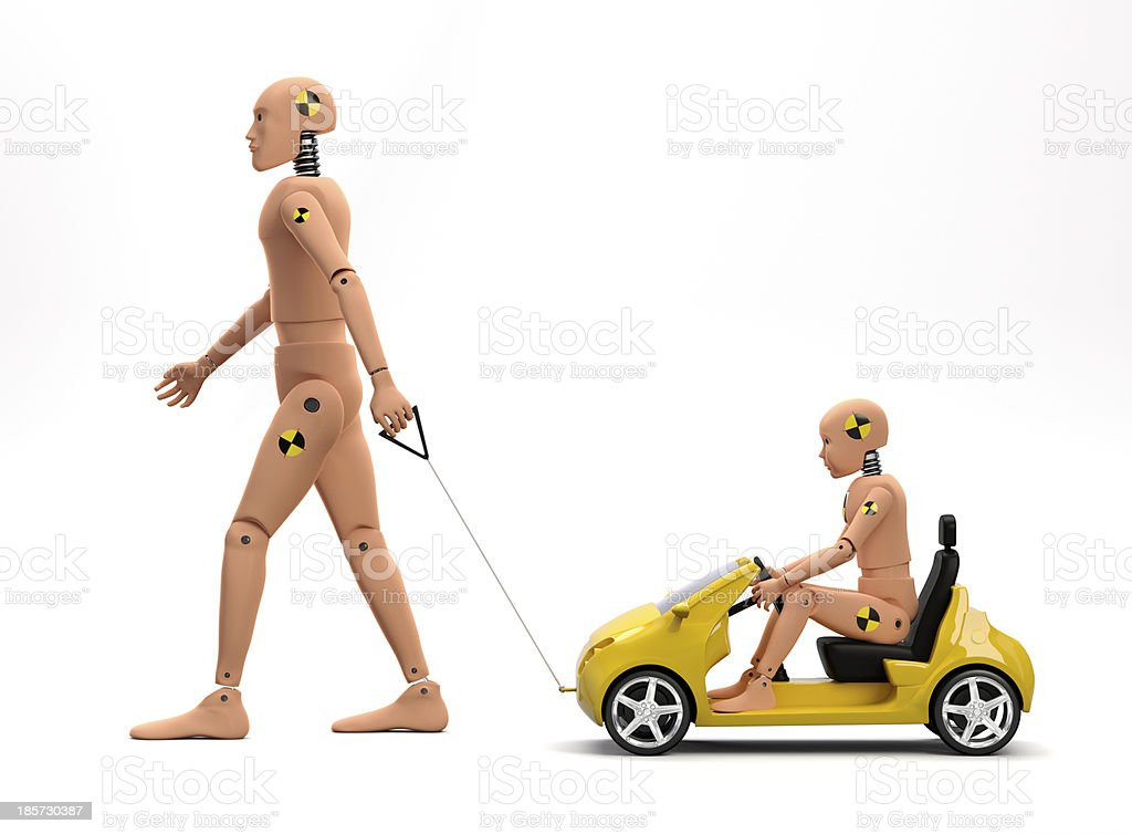 A crush test dummy pulling a car with a smaller dummy royalty-free stock photo
