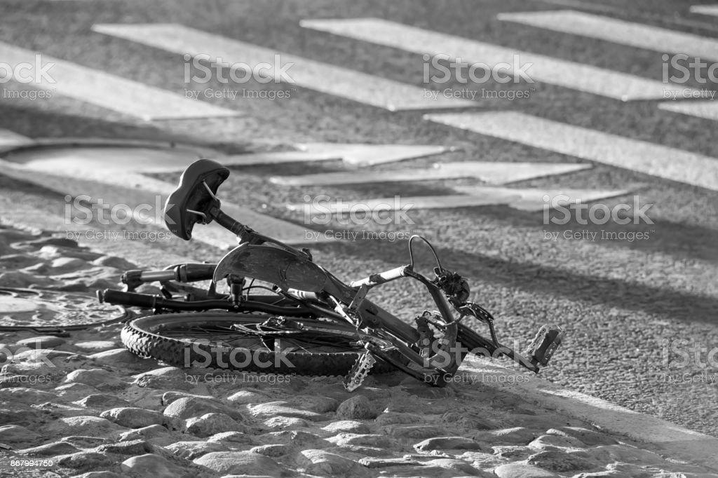 Crushed bike on the ground stock photo