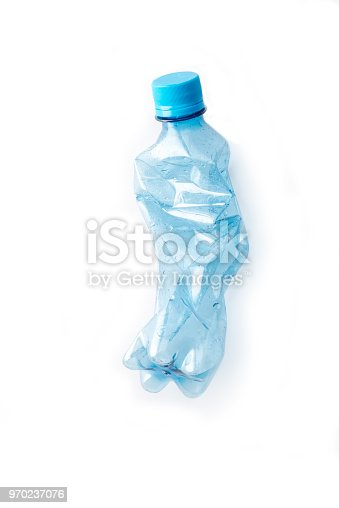 one pet bottle,  crushed on a white background, high angle view