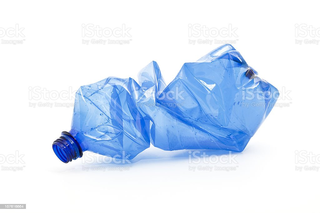 crushed blue plastic bottle stock photo