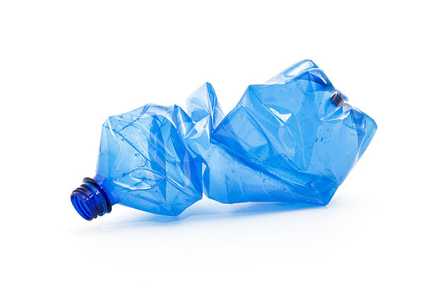 crushed blue plastic bottle - plastic stock pictures, royalty-free photos & images