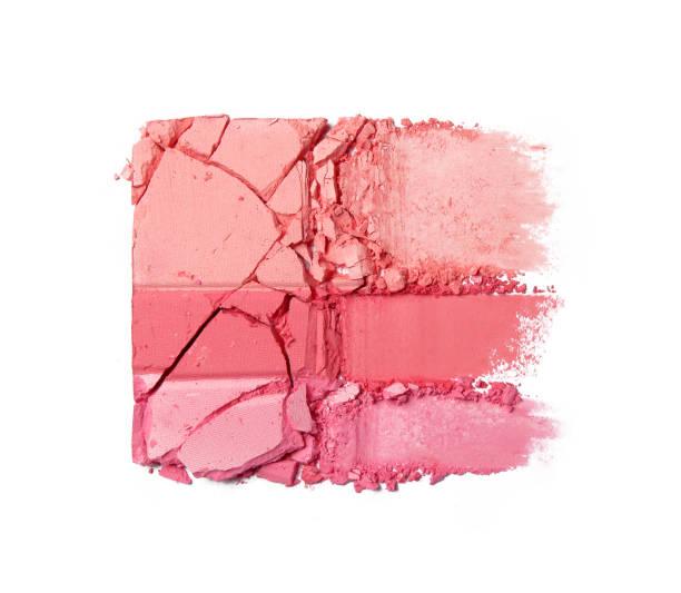 Crushed blush or face powder isolated on white stock photo