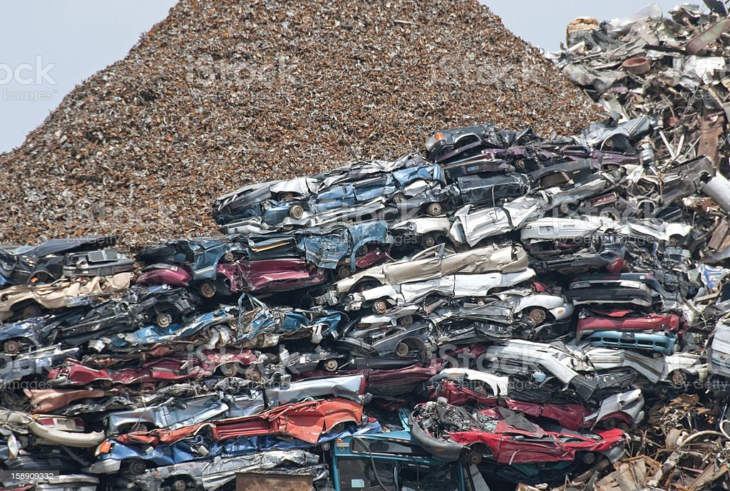 Crushed cars and shredded metal at recycling facility royalty-free stock photo