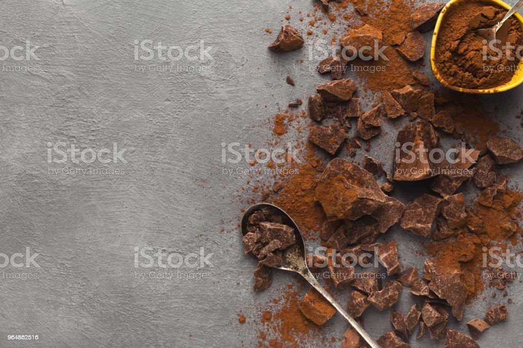 Crushed chocolate pieces on gray background, top view royalty-free stock photo