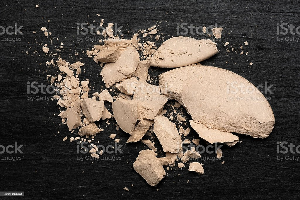 Crushed Compact Powder on Blackboard stock photo