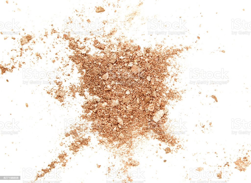 Crushed golden eye shadow isolated on white background stock photo