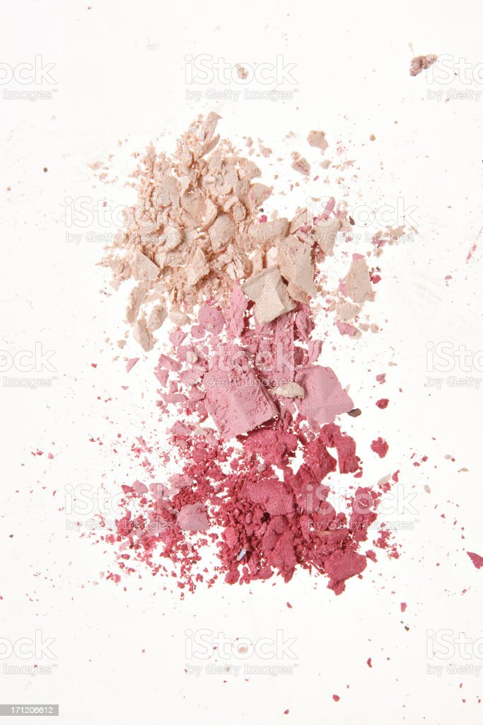 Crushed makeup powder in pink tones stock photo
