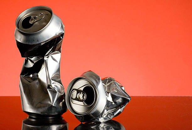 Crushed Two wrinkled and twisted beer cans.Similar from my portfolio: crushed stock pictures, royalty-free photos & images
