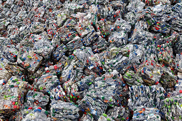 crushed plastic bootles - recycling stock photo