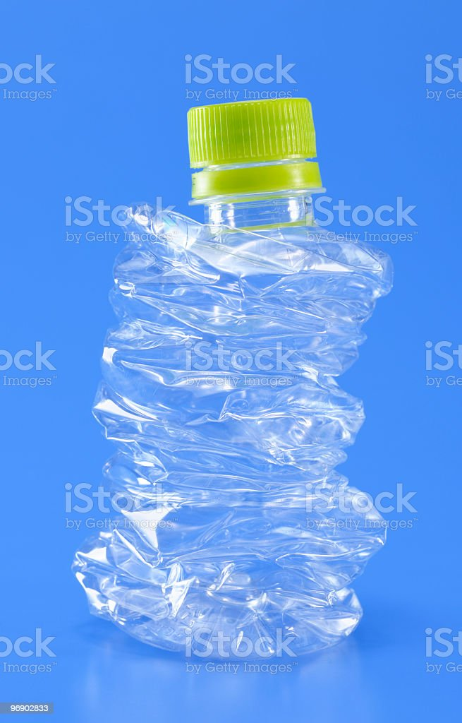 Crushed plastic bottle to recycle royalty-free stock photo