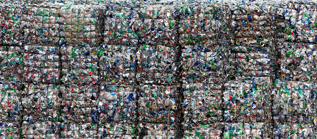 compressed plastic bottles waiting for recycling