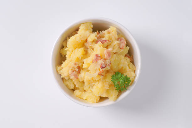crushed potatoes with bacon stock photo