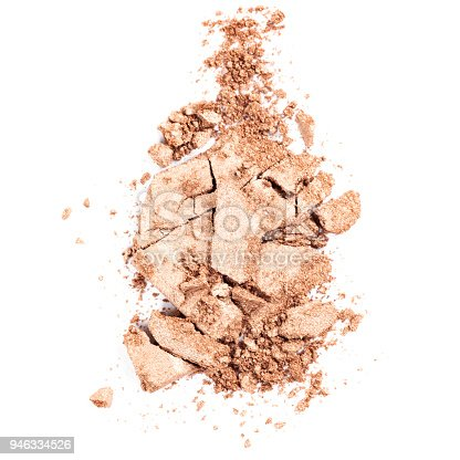 Crushed pressed powder foundation on a white background.