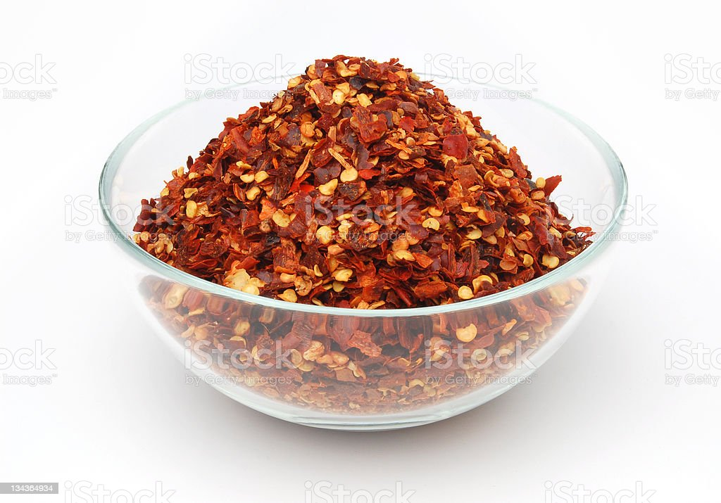 Crushed red pepper in bowl stock photo