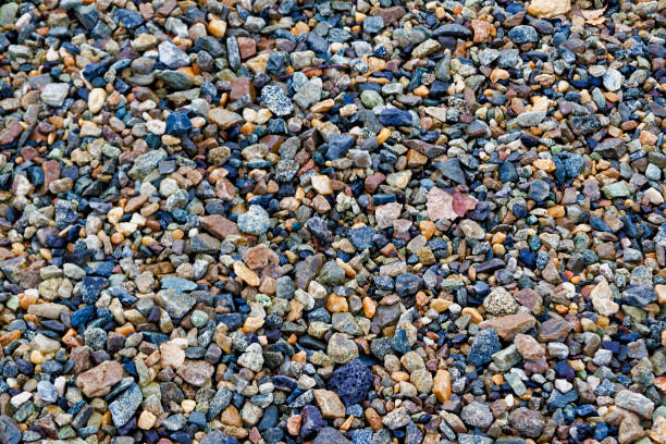 crushed stones texture background. stones construction rocks.grey granite gravel texture background. top view. - granite rock stock photos and pictures