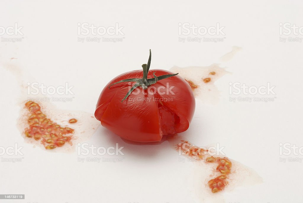 Crushed Sweet Cocktail Tomato on White Paper Background royalty-free stock photo