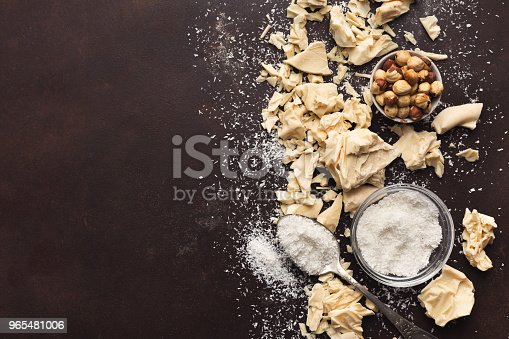istock Crushed white chocolate pieces and truffles on dark background 965481006
