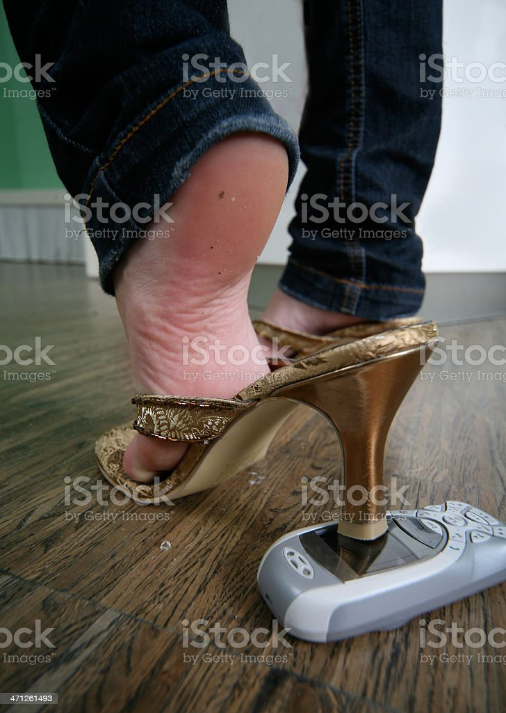 Crushing the phone with high heels stock photo