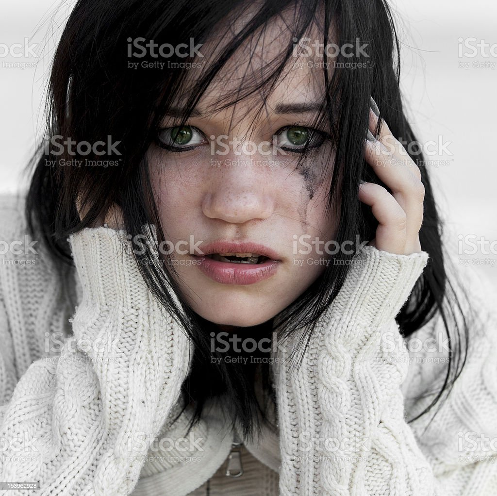 Cry girl in sweater. royalty-free stock photo