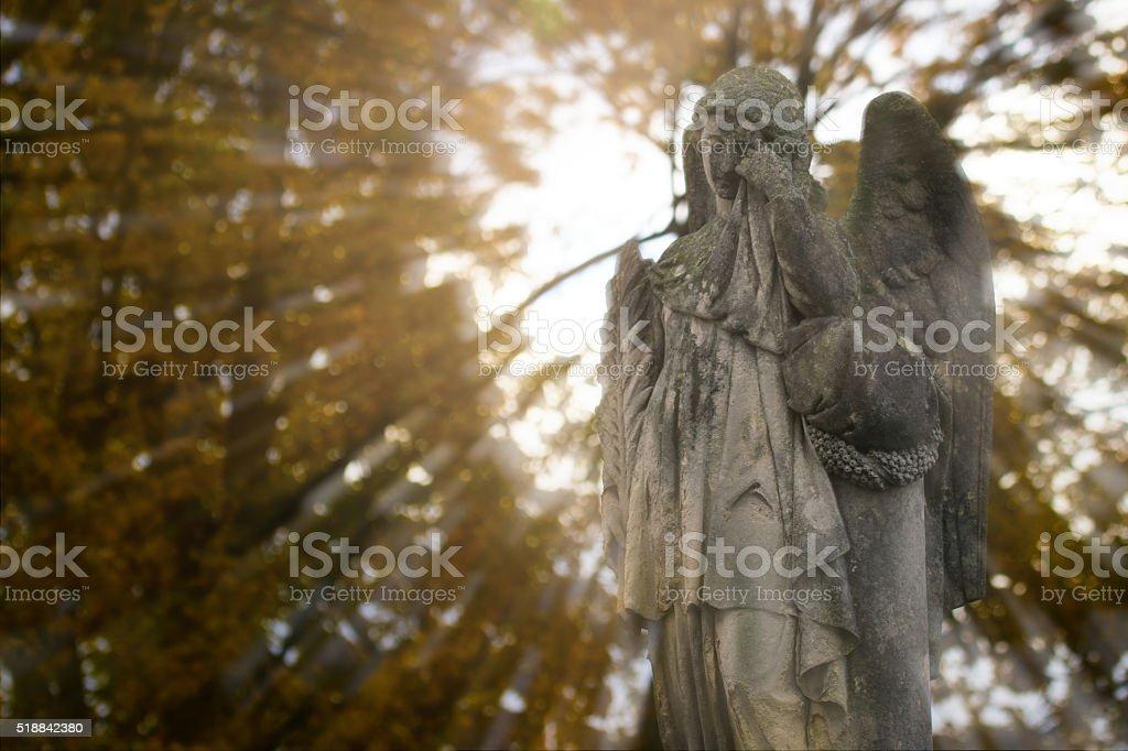 crying angel stock photo